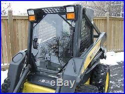 1/2 New holland LEXAN LS180 Skid Steer door and sides. Cab loader windows cab