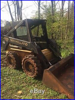 1999 New Holland LX665 Skid Steer With Grapple And Extra Wheels