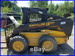 2003 New Holland LS180 Skid Steer with 576 hrs two buckets, forks, augers