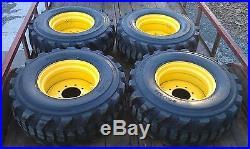 4 NEW 14x17.5 Skid Steer Tires & Rims for John Deere 14 ply rating 14-17.5