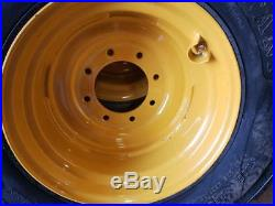 (4- Tires with Wheels) New Holland LS skid-steer tire size 14-17.5 14175