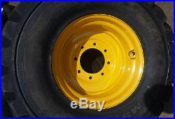 (4- Tires with Wheels) New Holland LS skid-steer tire size 14-17.5 L5 14175