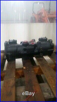 Hydraulic Pump Tandem, Used, New Holland, 87043493 skid steer