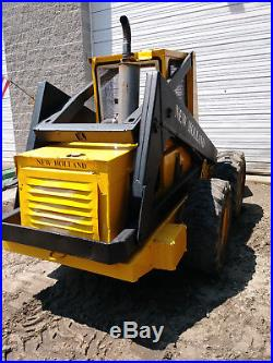 L785 NEW HOLLAND SKID STEER with 62 bucket and 4 cylinder perkins diesel engine