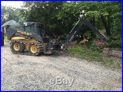 New Holland LS180 Skid steer loader with backhoe attachment