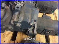 Tandem hydrostat pump New Holland LS190. B C190 LS185. B L190 87043496 skid steer